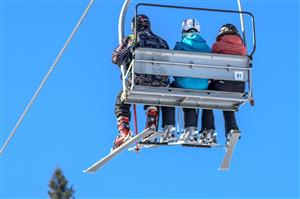 Skiers on Chari Lift